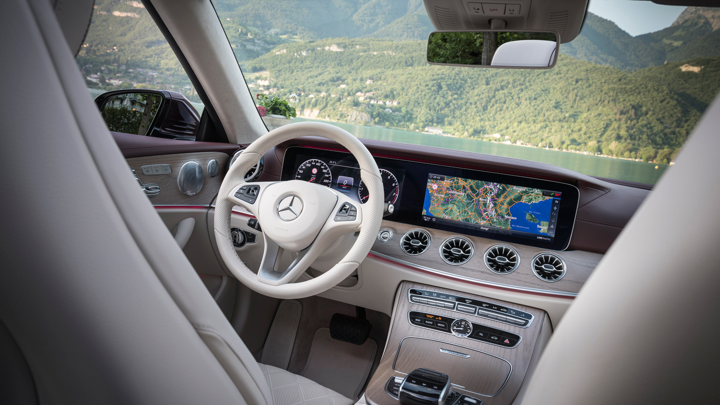 A photo of the comely cabin of the 2018 Mercedes-Benz E400 Cabriolet.