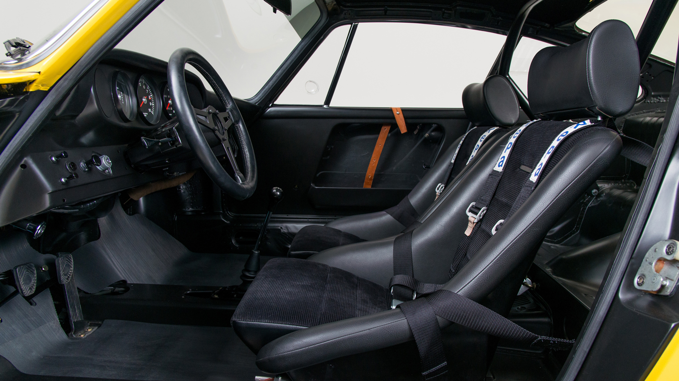 The interior of a restored Porsche 911 R.