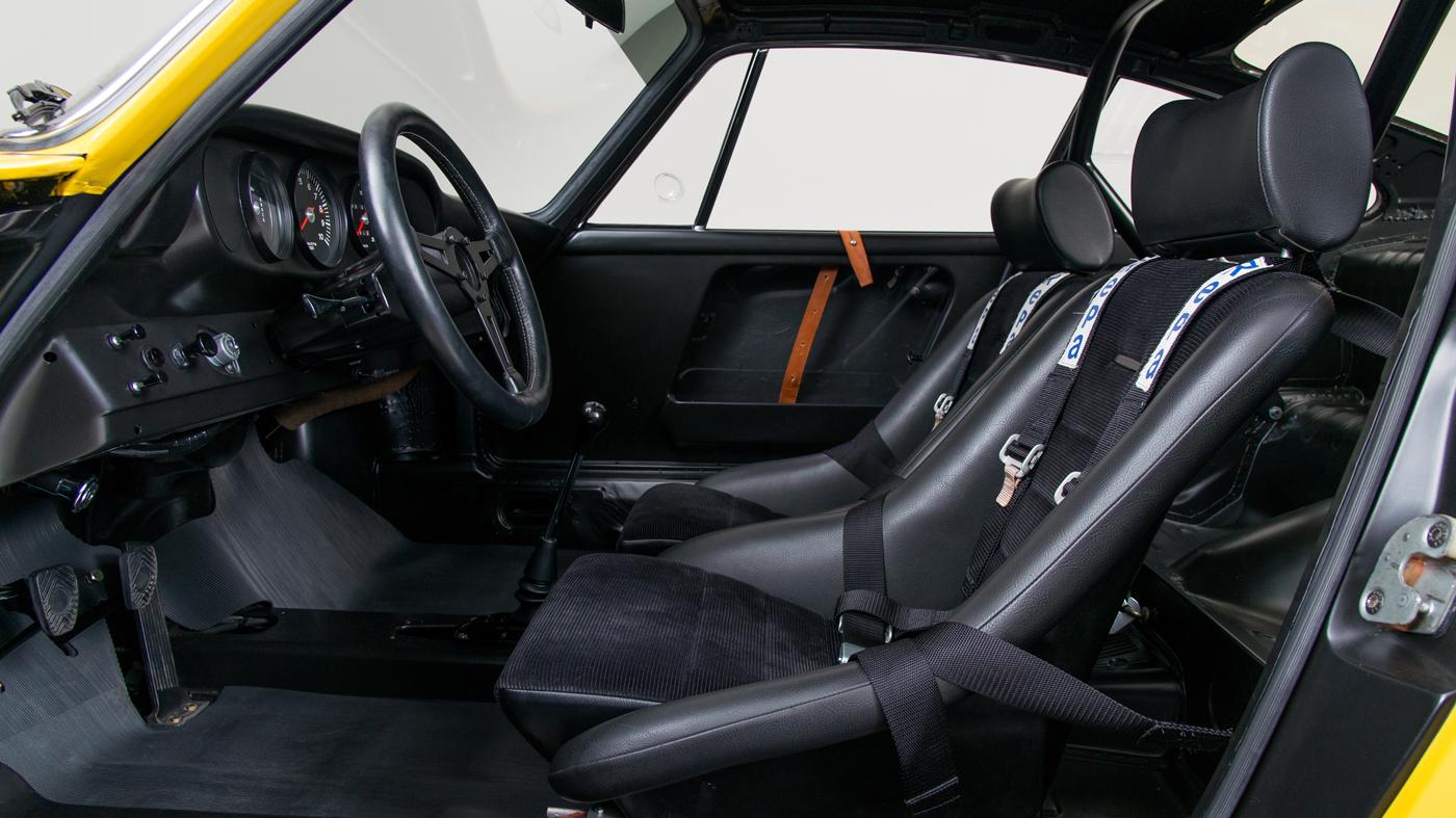 The restored Porsche 911 R's race-ready interior.