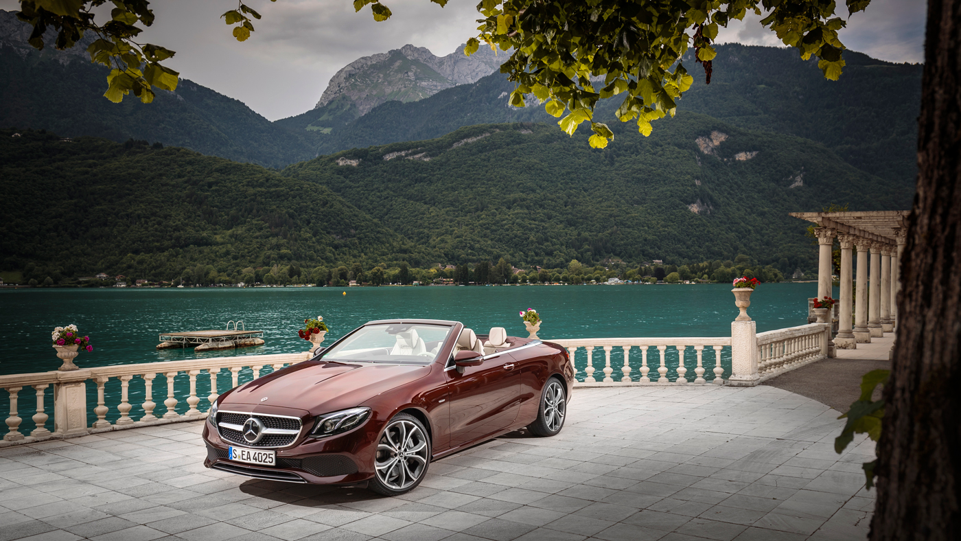 The Mercedes-Benz E400 Cabriolet with a lake in France in the background.