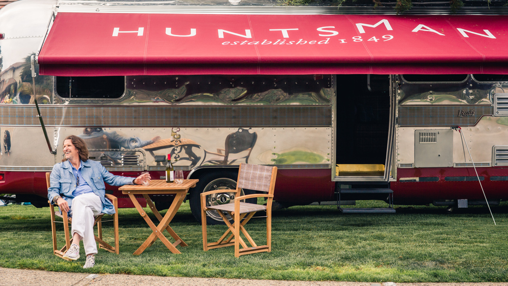 Pierre Lagrange relaxes at table outside of Huntsman Airstream
