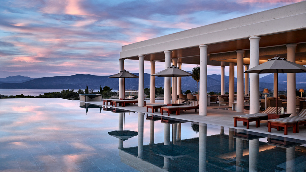 Amanzoe resort villa at sunset outdoor pool