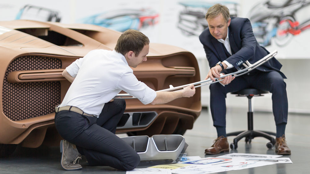 Bugatti design director Achim Anscheidt checks on the Chiron's tail-lamp bevel, a 63-inch-long single piece of milled aluminum.