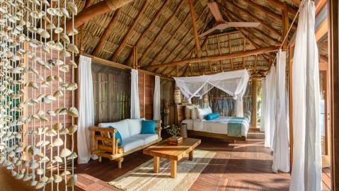 Island bedroom in villa with seashells