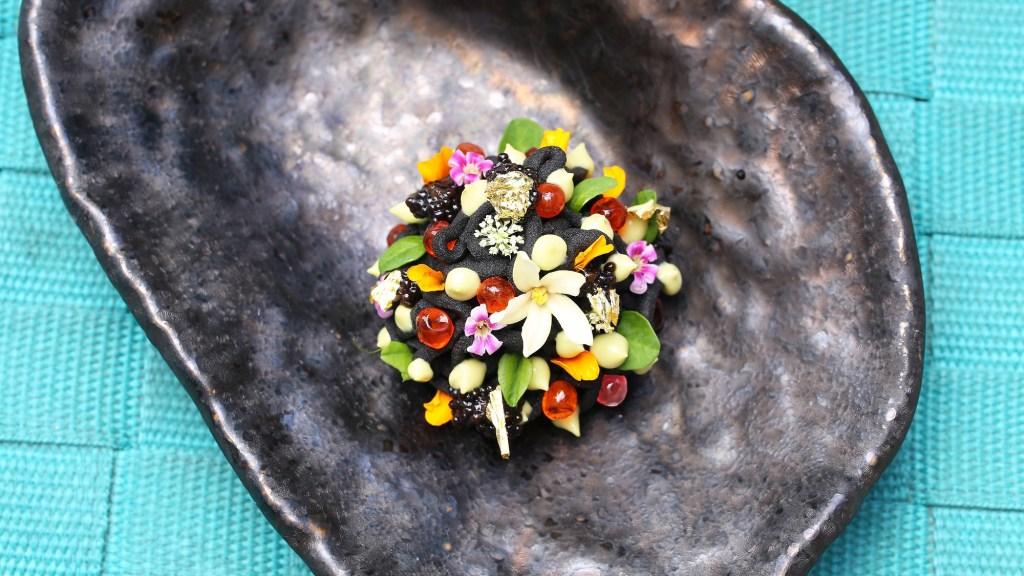 Peruvian causa on a black plate