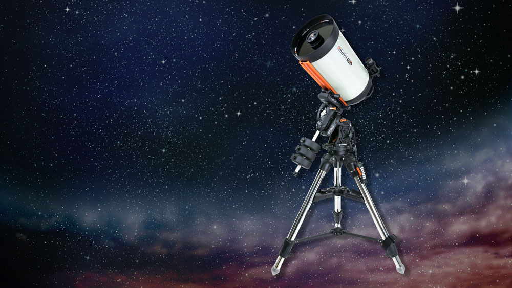 Celestron CGX-L Equatorial 1400 HD telescope on mount against starry sky