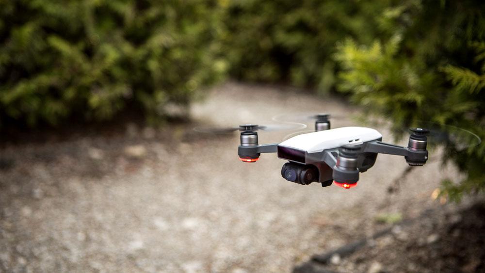 white DJI Spark selfie drone hovering