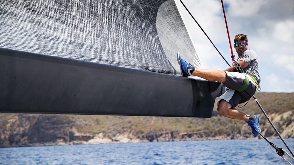 Dream Regatta sailboat with sailer in action on the jib