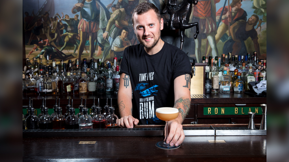 Bartender Jack McGarry offers a cocktail at BlackTail bar in New York City