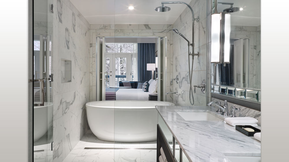 White bathroom with a soaking tub and rainfall shower