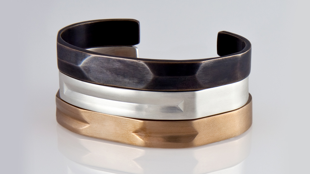 Editions de Re blackened bronze, sterling silver, and red-gold cuff bracelets