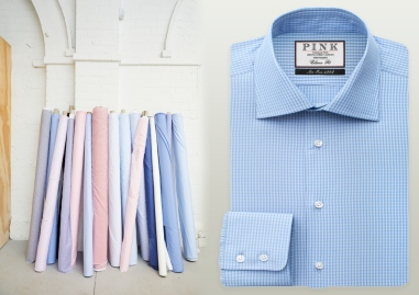 Fabric lined up against a brick wall and men's shirt
