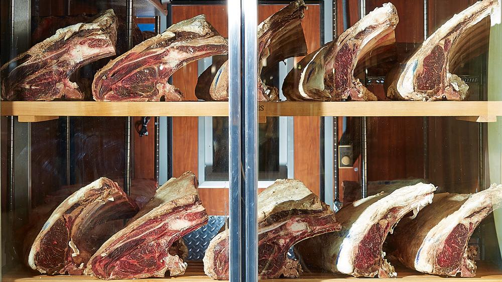steaks in a locker at Knife in Dallas