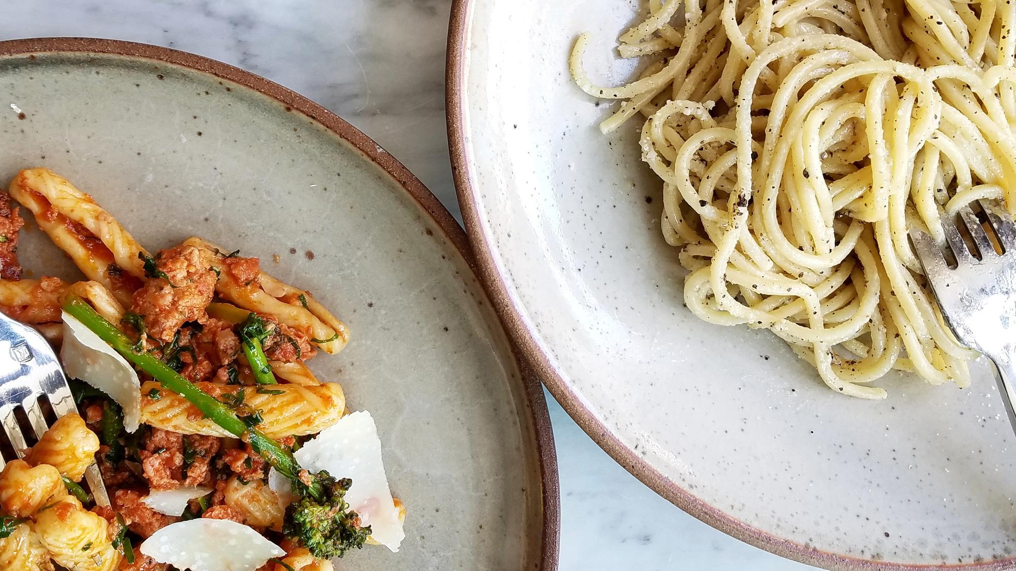 Capunti with sausage sugo, broccoli di cicco, peperoncino, and pecorino