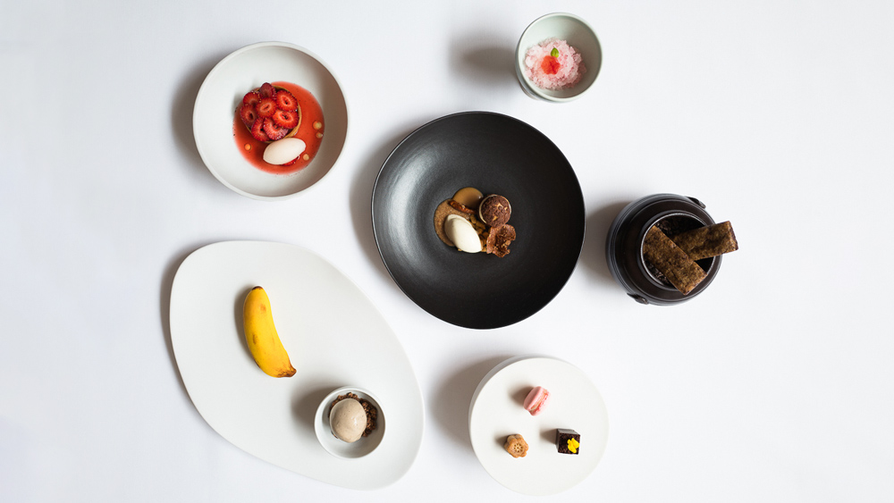 chocolate and strawberry desserts on a white table