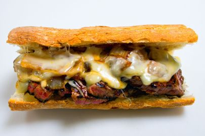 steak sandwich with cheese and onions