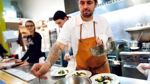 Ludo Lefebvre plates a dish at Trois Mec