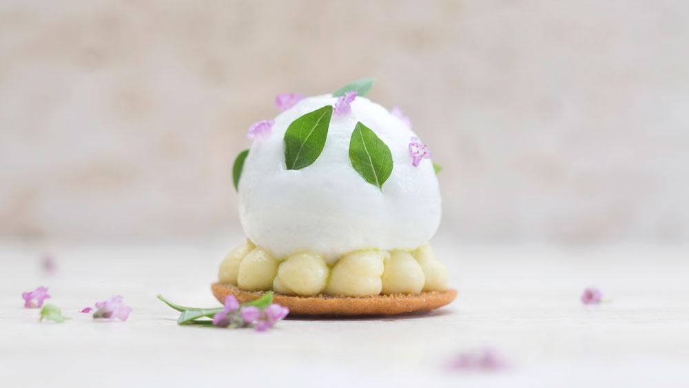 Lemon tart with meringue and flowers