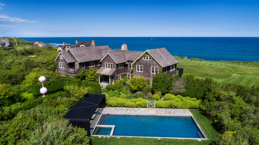 wide view of waterfront home and swimming pool in Montauk, New York