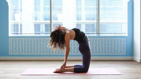 New yoga studio on Sunset Boulevard, woman practicing