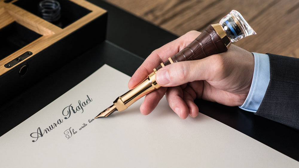 Anura Rafael Write Time used as a pen with watch mechanism on top