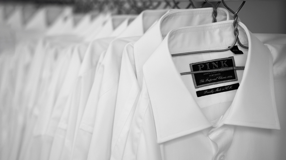 black and white photo of white button down shirts.