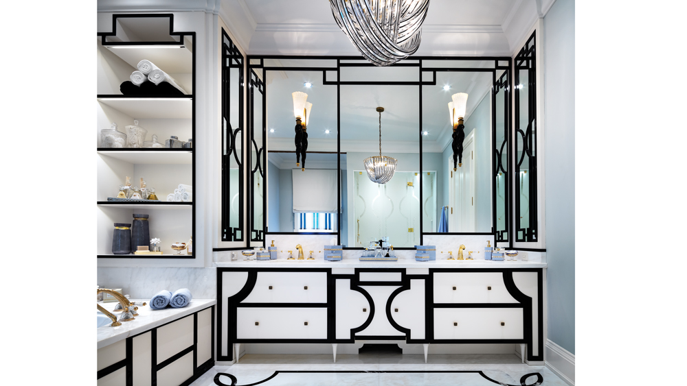 Black framework around the mirror and strong geometric lines bring Art Deco motifs into the master bath.