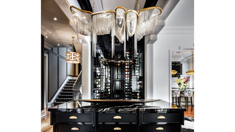 The marble-topped island is at the nexus of the home's first-floor entertaining spaces.