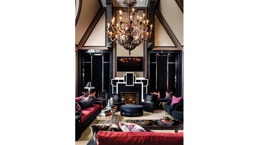 Seating niches flank the fireplace in the plush great room canada toronto mansion