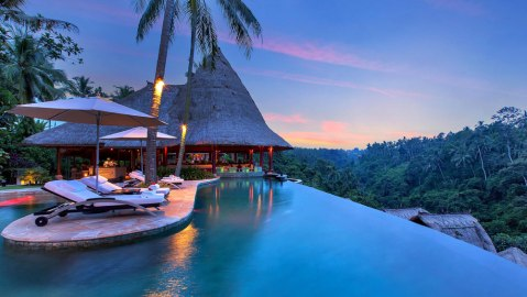 swimming pool in the evening at Viceroy Bali