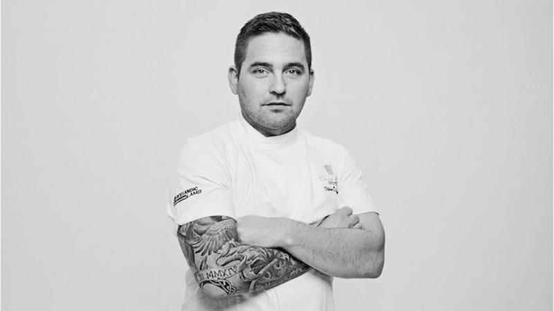 tattooed in white chefs jacket