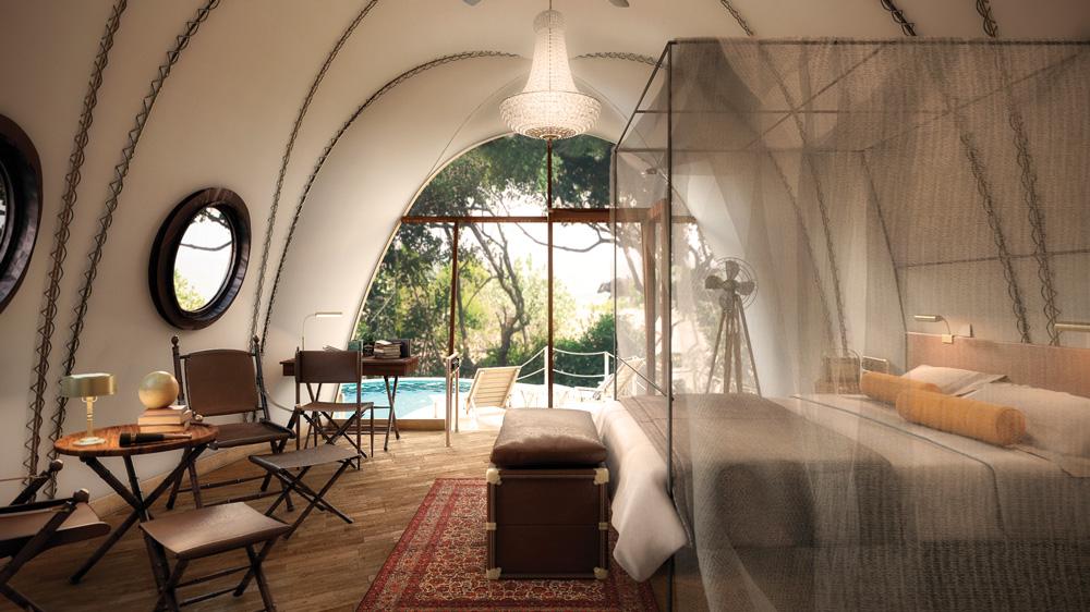 wild coast tented lodge room interior of bedroom overlooking pool