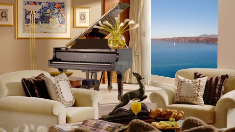 living room with piano in Royal Penthouse Suite at Hotel President Wilson in Geneva, Switzerland