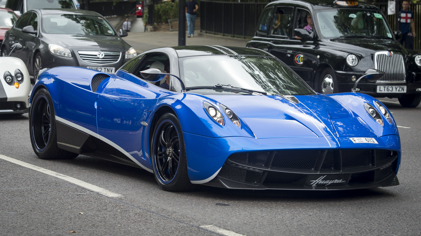 A Pagani Huayra rumbles down a road in London.