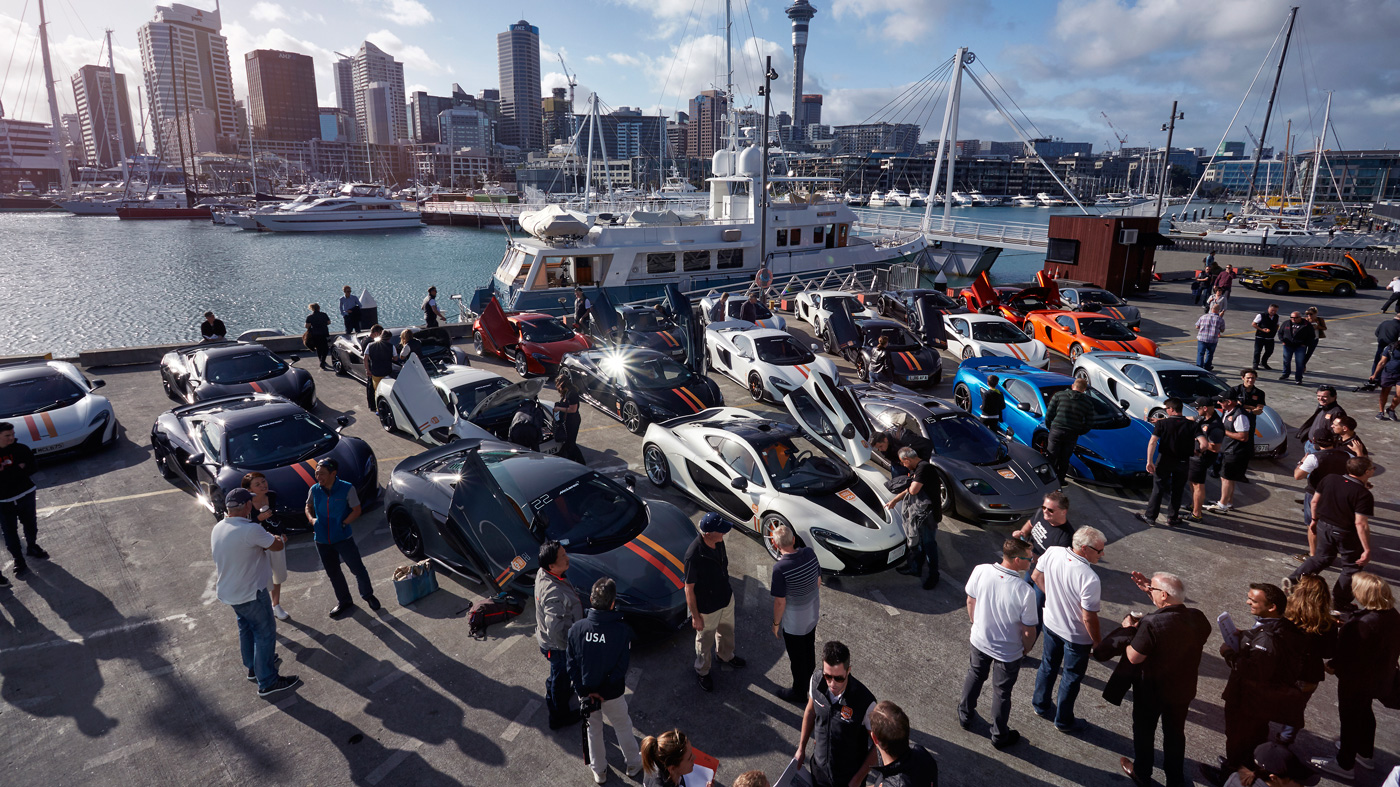 The cavalcade of 32 McLarens get ready to depart from New Zealand's Auckland Harbor.