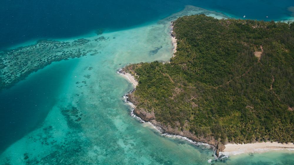 private island Fiji forest blue water
