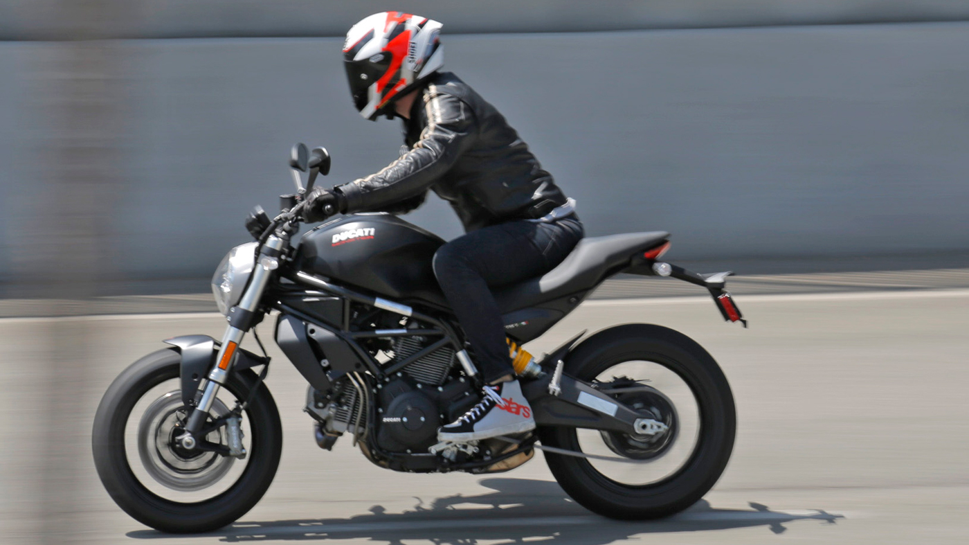 A motorcyclist on a Ducati Monster 797.