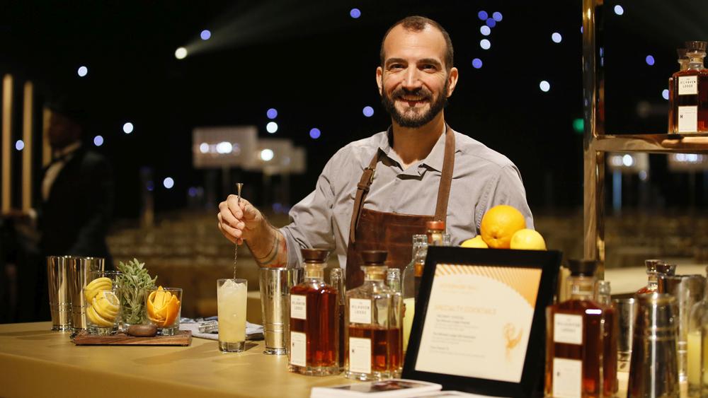 Mixologist Charles Joly behind bar