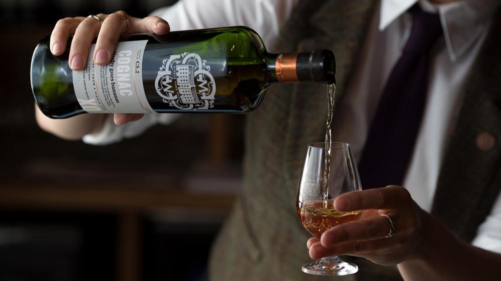 server pouring Cognac