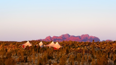 Australia outback safari lodge with rock formation