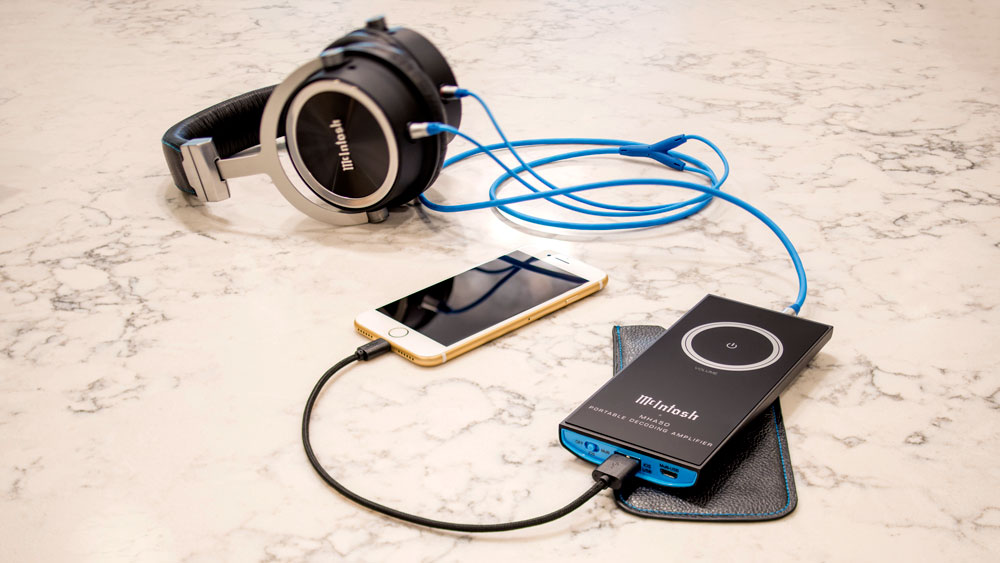 McIntosh MHA50 decoding amplifier and MHP1000 headphones with iPhone marble