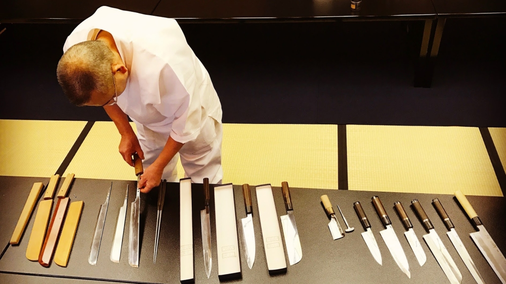 Japanese chef organizing his knives at Kichesen