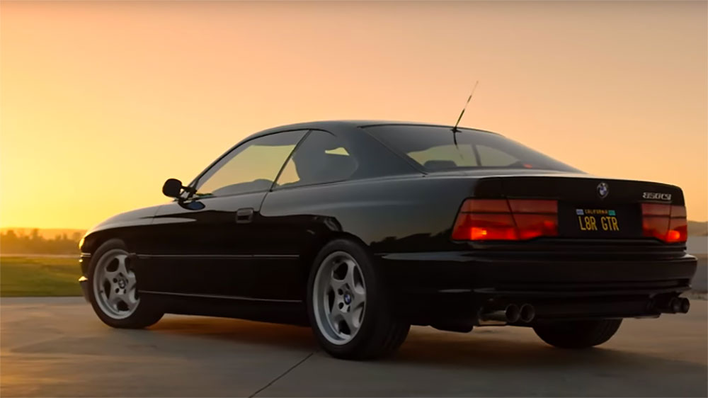Taylor Patterson and his BMW 850CSi at the end of a drive.