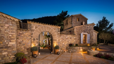 stone villa with courtyard at night