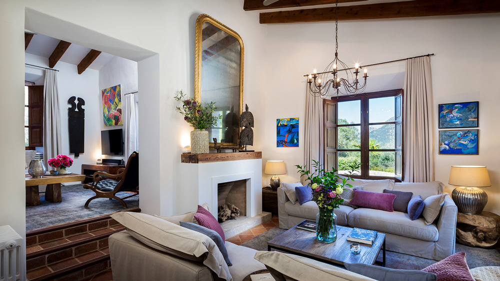 living room with fire place and art in vacation villa