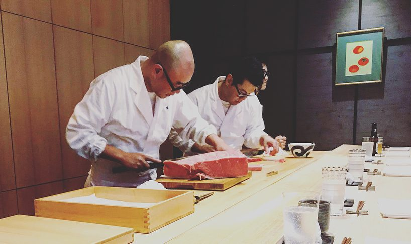 sushi chef cutting tuna