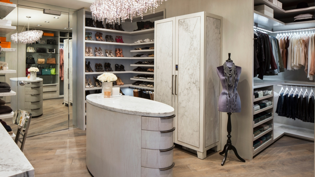 closet with vanity, drawers, shelves