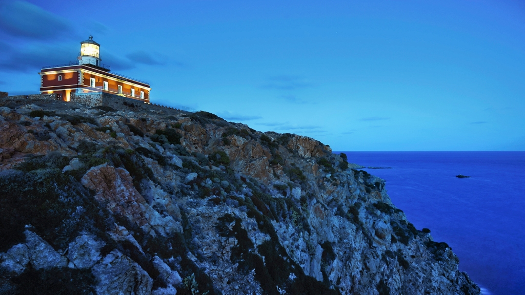 Lighthouse hotel on a clifftop in Italy