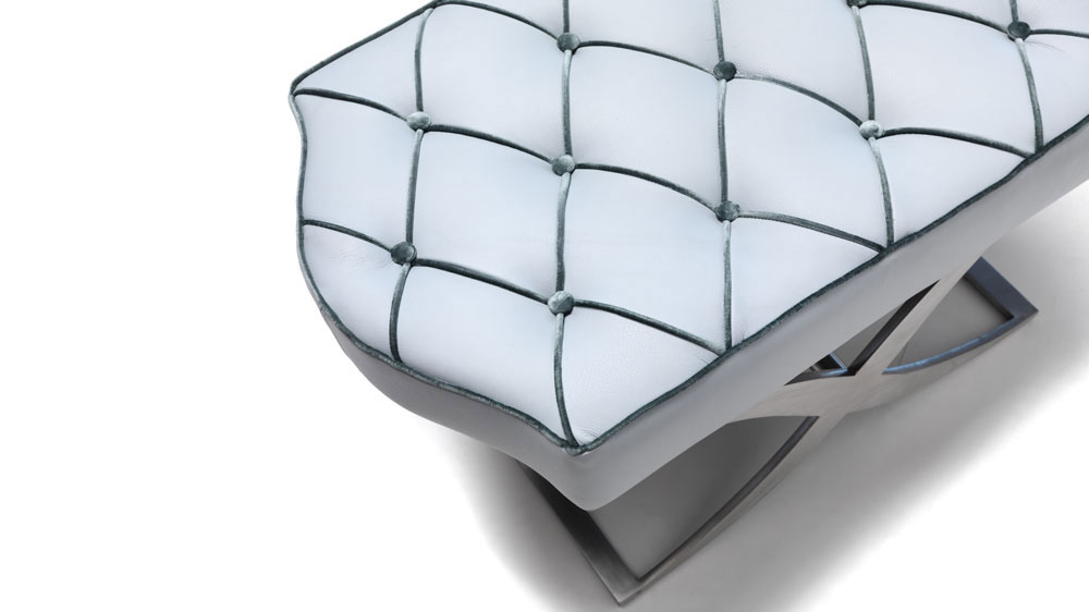 Curved leather and metal ottoman