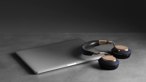 Bowers & Wilkins PX in gold with laptop
